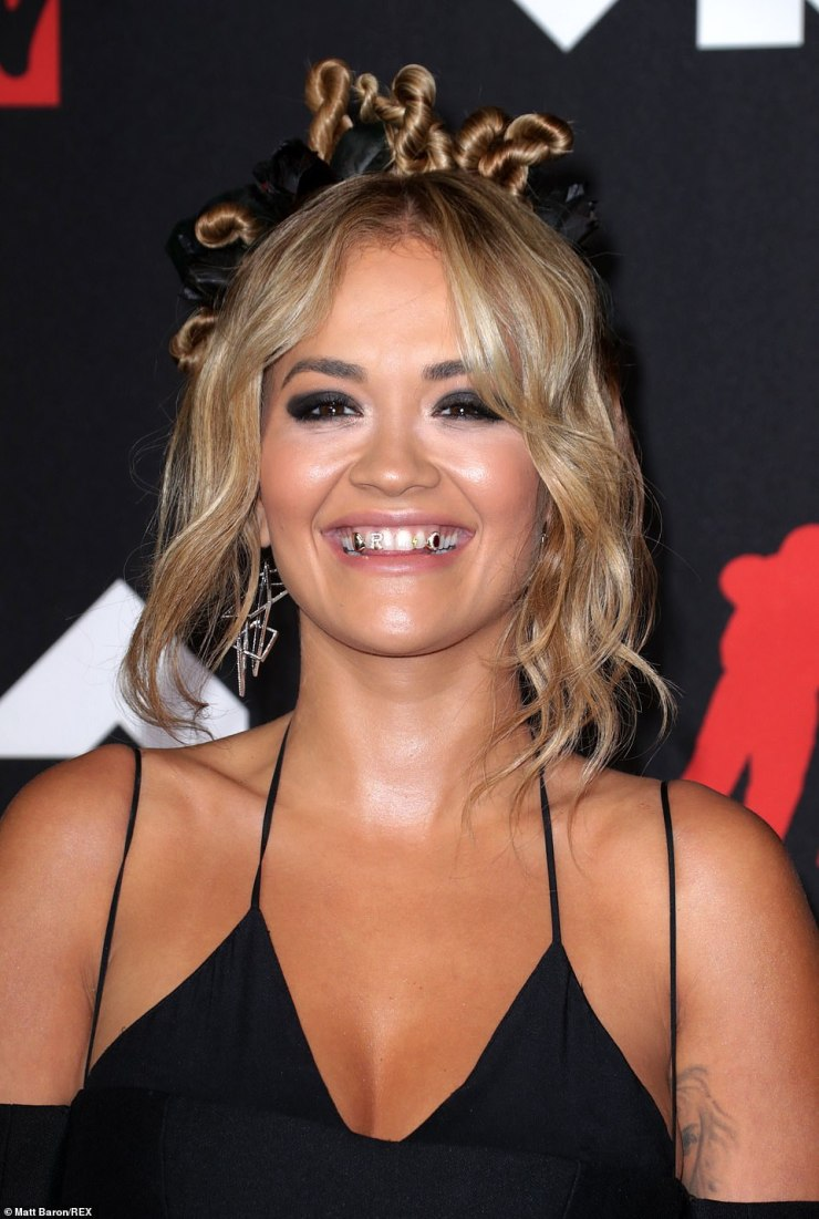 Wild: If that wasn't enough, Rita added to her wild outfit with gold grills on her teeth - including a diamond-encrusted 'R'