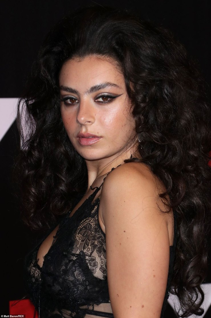 Beauty:Charli, real name Charlotte Emma Aitchison, pulled out all the stops for the evening's look, completing her makeup with winged eyeliner