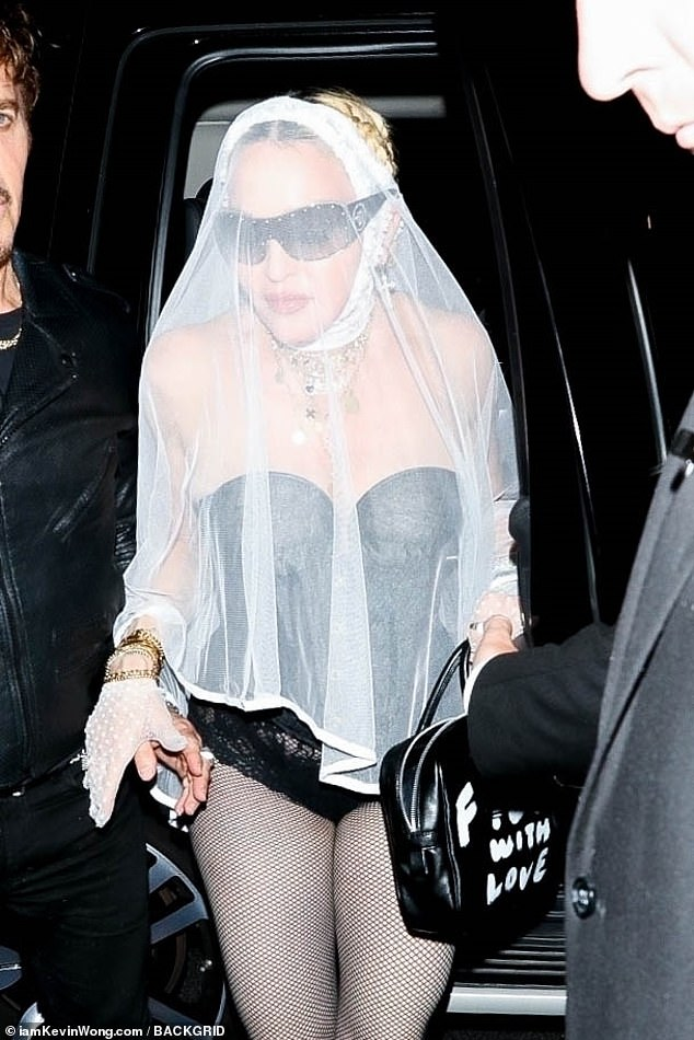 Bridal vibes:Spotted leaving a party hosted at 1 Oak, she covered her face with the lacy veil and chunky sunglasses, adding delicate white gloves to the look