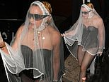 Madonna hits the VMA after-parties in a wedding veil teamed with a leather bodysuit and fishnets