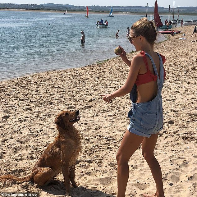 James shared a snap of the stunning financier through his business account Ella Co, showing Alize on the beach playing fetch with his adorable pooch