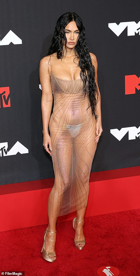 Showstopping: Megan, 35, sent tongues wagging as she showed up in a revealing sheer dress fashioned by Mugler as she donned a see-through dress and flashed a G-string while on the arm of beau Machine Gun Kelly, 31
