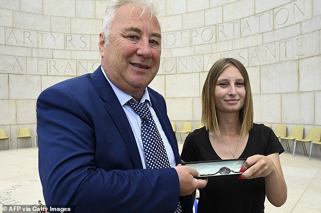 The airman's nephew Paul Habgood (left) and his sister Marilyn Corrigan (right) were finally able to take possession of the prized bracelet during a ceremony that took place at the concentration camp