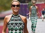 Amanda Holden saunters out of Heart Radio in a retro-print halterneck jumpsuit