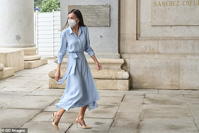 The Spanish royal looked typically polished in a recycled, pale blue Pedro del Hierro shirt dressteamed with a pair of stylish nude leather heels