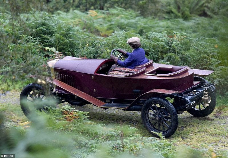 Having a blast! She appeared to be in her element as she drove through a lane in a retro Chitty Chitty Bang Bang style car