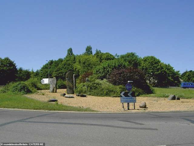 MARCH: This 'mysterious looking' roundabout can be found in Basingstoke, and features up-right ancient stones, gravel, trees, bushes and shrubs. Basingstoke has so many roundabouts it is has been dubbed Doughnut City.