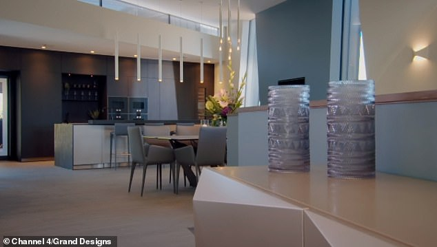 Supercar investor and property developer Joe O'Connor, 35, and his wife Claire, from Devon, appeared on a Channel 4 event where they set out with a budget of £835,000 to build a massive house inspired by cliffs in the countryside ( pictured, living area)