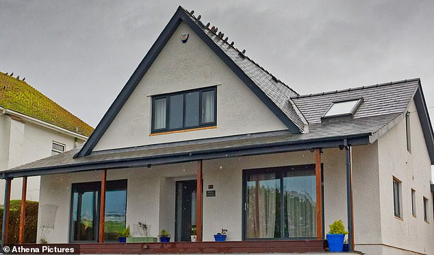 Ms Brown was a deputy manager working for aircraft handling firm Servisair before winning £5.5m on the lottery. Pictured: The home where the attack happened