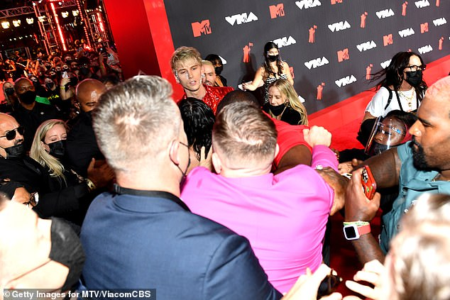 Rough night:Ahead of the ceremony, MGK and Conor McGregor were spotted squabbling on the red carpet