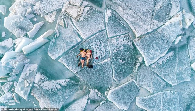 Alexandr Vlassyuk snagged runner-up in the People category with this brilliant photograph, titled Beach Season. He took the photo in February 2021 on ice hummocks at the Kapchagai reservoir in the Almaty region in Kazakhstan. 'The air temperature on that day was -10 degrees Celsius. For our region and season it could be said to be warm, and so, without waiting for summer, we decided to open the beach season,' the photographer explains