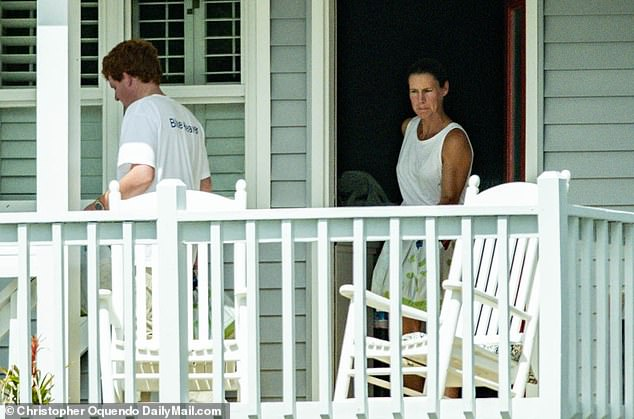 He was seen with a woman believed to be a family member arriving at the family beach home early Friday afternoon