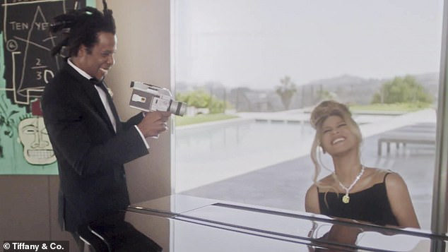 Mood 4 Eva: She switched gears into a flawless black gown with cut-out panels to play the piano while her husband filmed a home video at the palatial pad