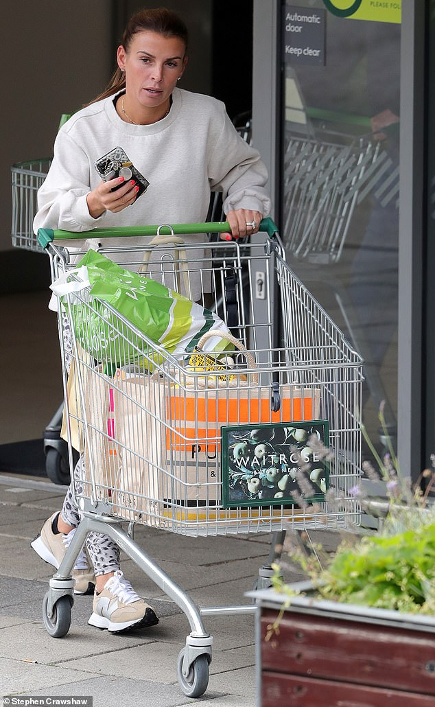 Stocking up: On Monday, Coleen Rooney, 35, wore an animal print leggings and plain jumper to do a supermarket run in Cheshire