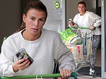 Coleen Rooney wears an animal print leggings and plain jumper to do a supermarket run in Cheshire