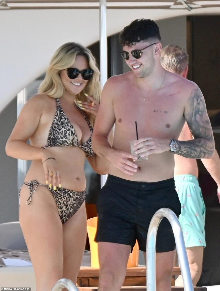 Holiday romance:Emily Atack's end of summer getaway heated up on Sunday, when the star, 31, was seen kissing a mystery hunk poolside at Marbella hotspot Ocean Club