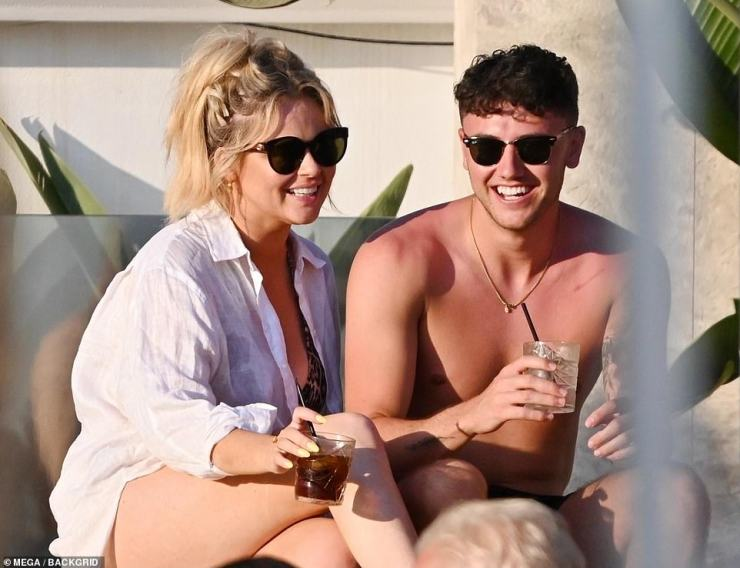 Looking good:Emily looked sensational in a leopard print bikini while cosying up to the tattooed hunk, and could barely stop smiling while in his company