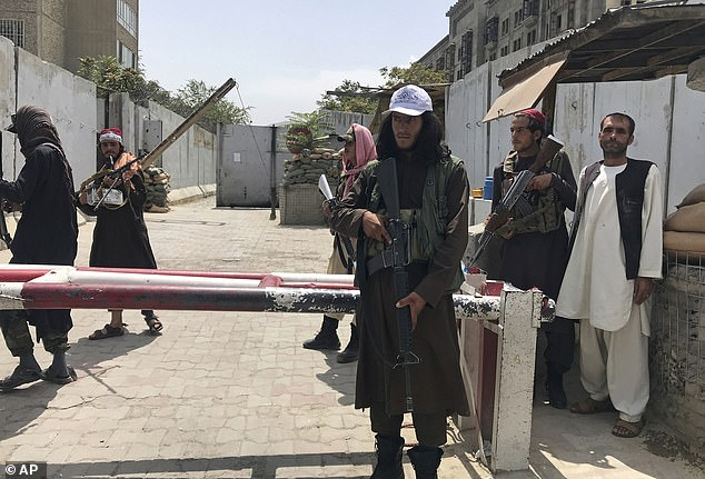 Before the family could reach US soldiers at the gate, they had to go through two Taliban checkpoints (pictured on August 17) where fighters were ordering crowds to go away, firing machine guns into the air, and striking stragglers with the butts and straps of their weapons