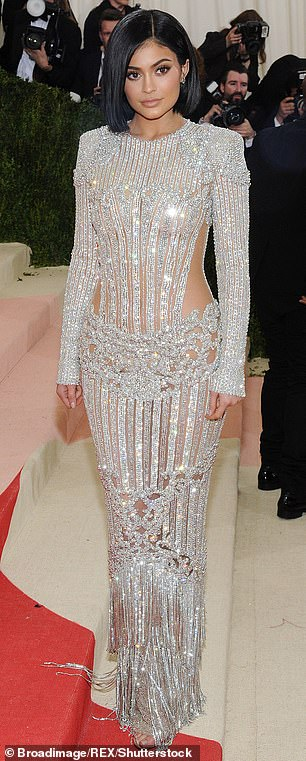 Fashion icon: Kylie has not missed a Met Gala ever since she first started attending in 2016, where she dropped jaws in a dazzling silver Balmain dress (pictured L in 2016)