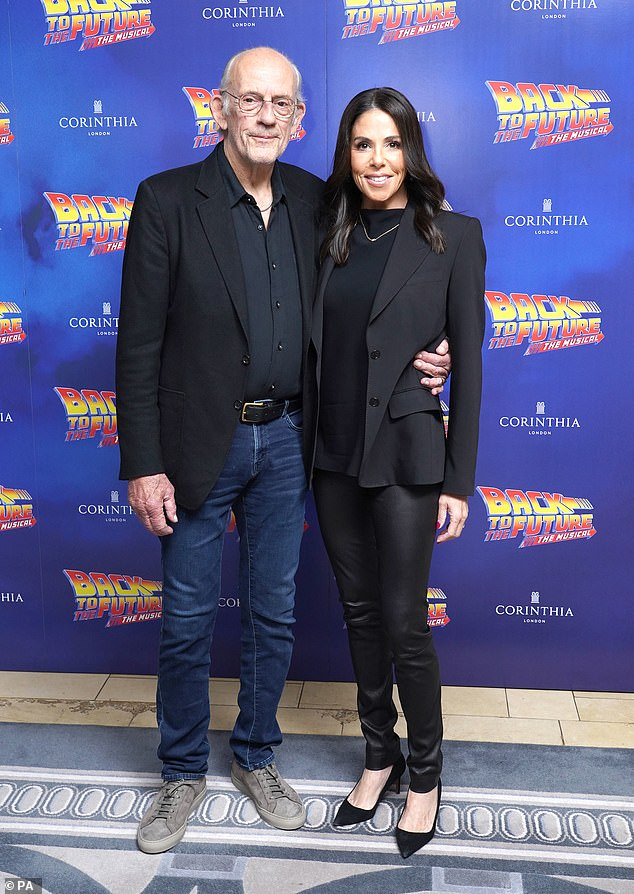 Happy couple: Christopher was joined by his wife Jane Walker Wood, 61, who looked stylish in black leather trousers and a black blazer