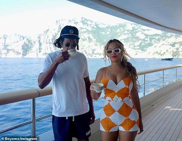 Tea time: Beyonce looked chic as can be while sipping on a cup of tea overlooking the crystal blue waters off the Italian coast