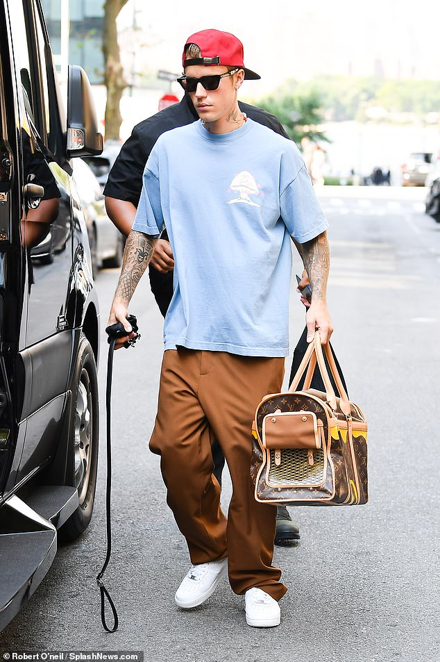 Productive day:Earlier in the day, Justin was seen carrying Oscar in his adorable Louis Vuitton carrier as he ran errands