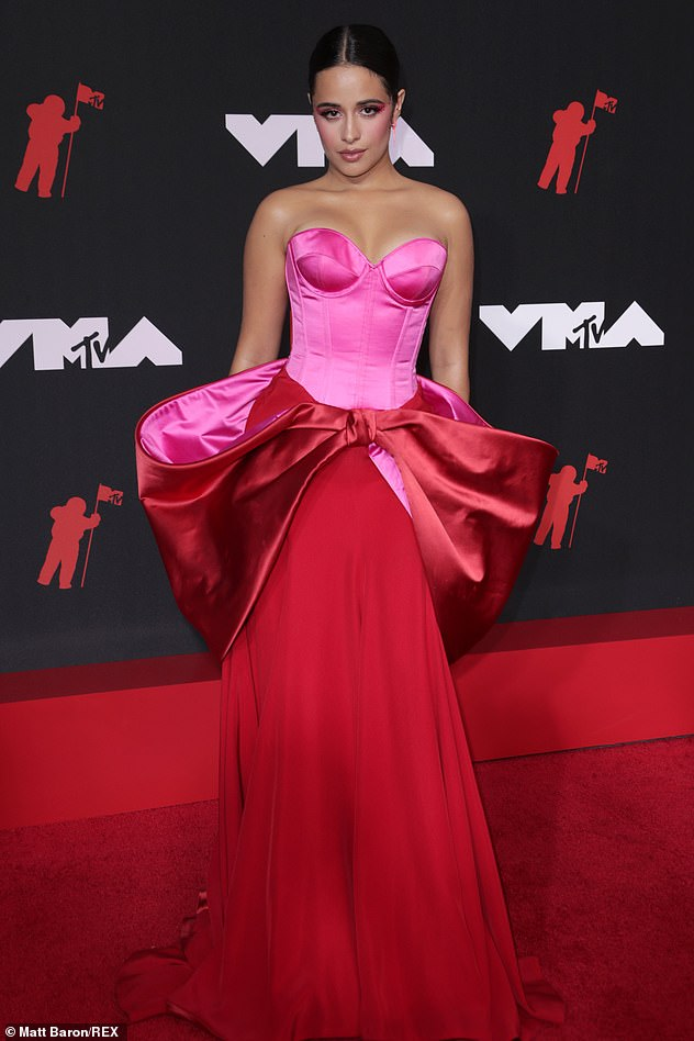 Bow down:The 24-year-old singer made her red carpet debut at the MTV VMAs wearing a stunning pink and red satin gown with a massive bow detail