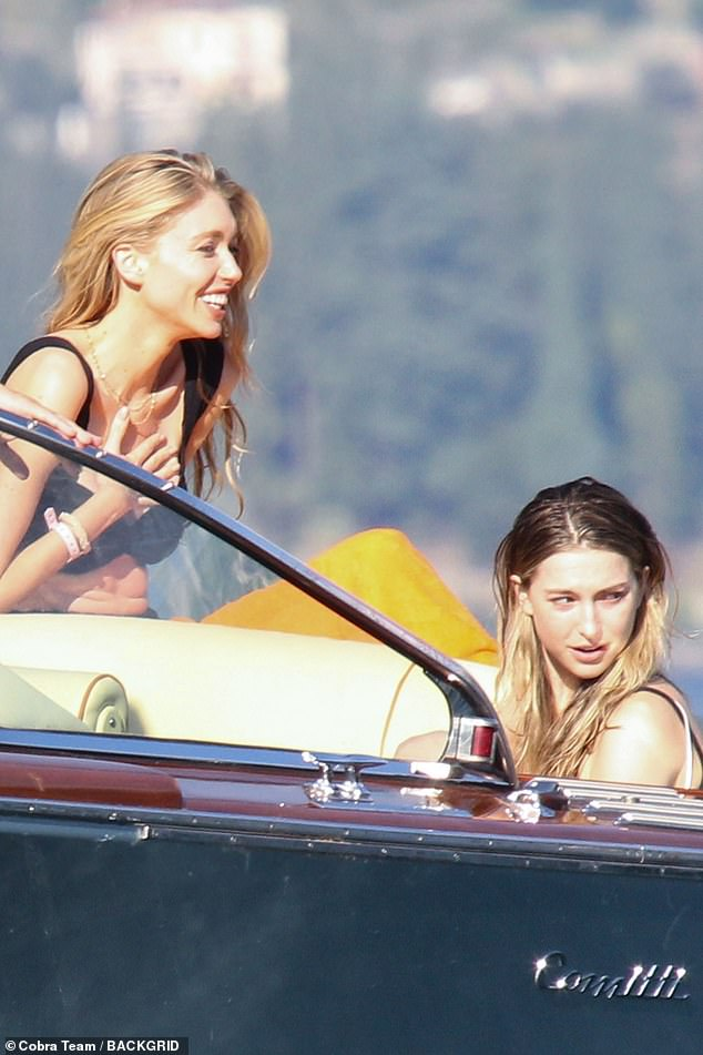 Fun in the sun: Steve Jobs' daughter Eve (right) looked in good spirits as she enjoyed a boat trip with friends in Italy's Lake Como on Monday
