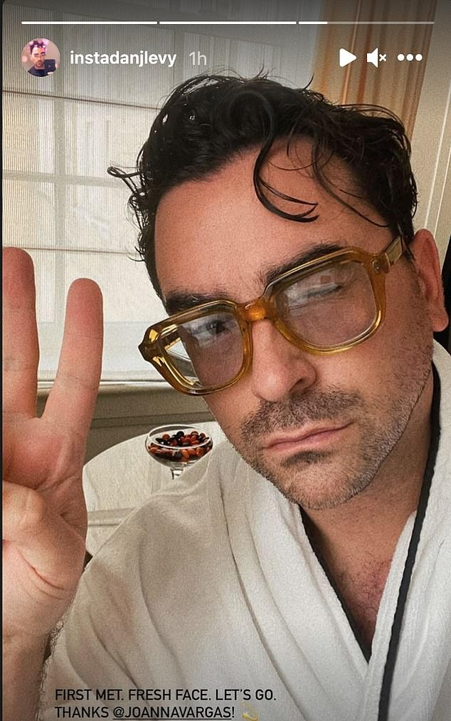 A side of chocolates behind him: Dany Levy of Schitt's Creek was in a robe at his pad