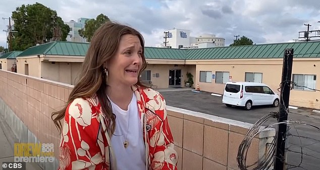 Emotional:Drew Barrymore rang in the premiere of season two of The Drew Barrymore Show with a visit to the mental health institution that she was put in at 13 years old for 1.5 years. The 46-year-old movie star, who took sat on top of her car outside of the fence of the facility, got emotional about the time she spent there