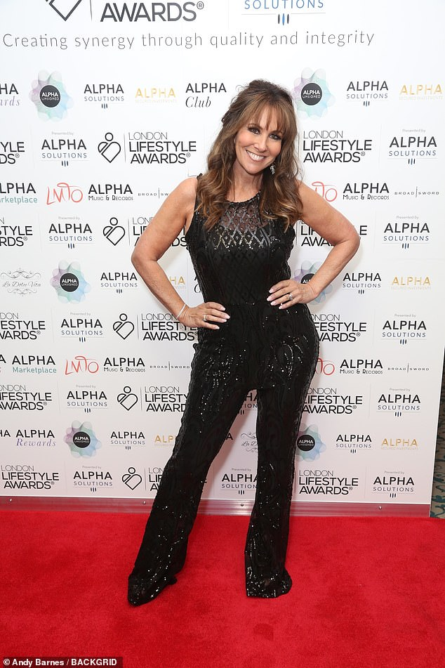 Glam:Linda showcased her trim physique in the dazzling ensemble, which boasted mesh panelling at the décolletage and bell-bottom trousers