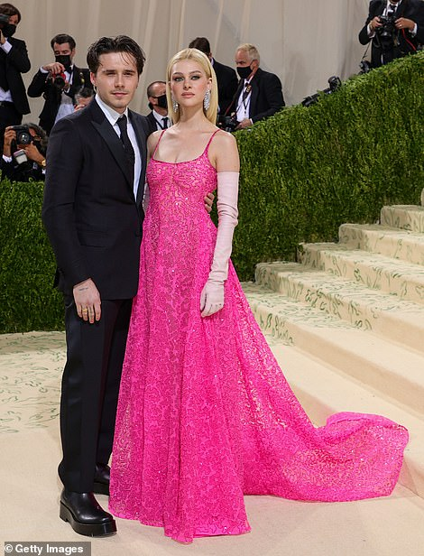 Lovebirds: Nicola wowed in a hot pink sheer patterned gown and elegant blush colored gloves