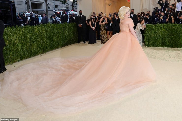 Princess moment: Met Gala Co-chair Billie Eilish looked absolutely beautiful in a peach corset gown with Marilyn Monroe inspired tresses; she is in custom Oscar de la Renta