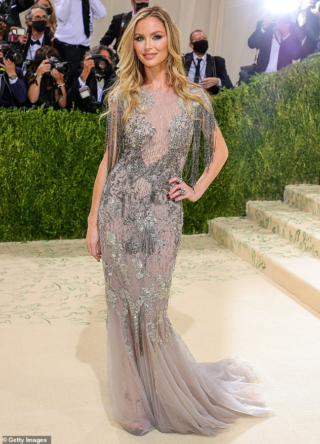 Stunning in silver: The Marchesa designer, 45, dazzled in a beaded grey gown with tons of dreamy tulle