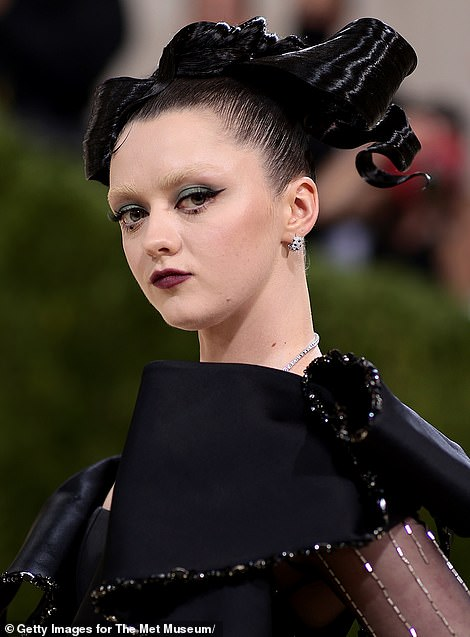 Hair today... The 24-year-old actress bleached her dark brows for the event, and she wore some over-the-top green eye makeup to draw even more attention to her eyes