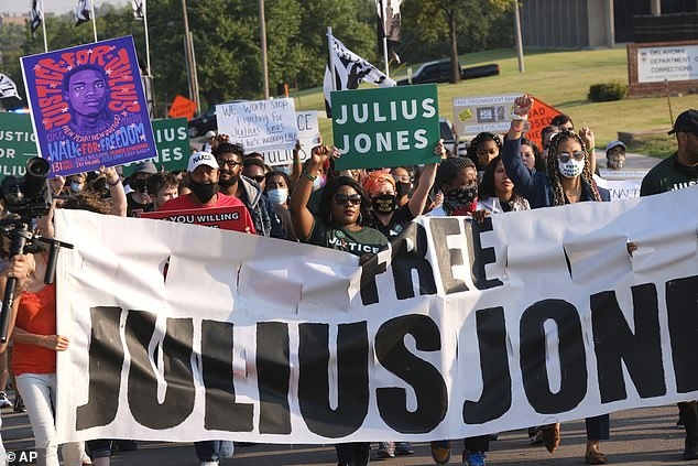 Demonstrators march in support of Julius Jones, who has been incarcerated for more than 20 years for a crime he says he did not commit