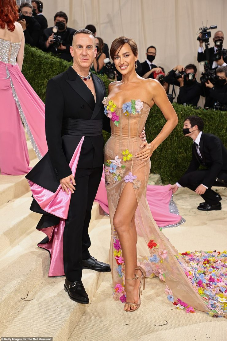 Sheer: The see-through number had a corset top and a thigh high split; posing with designer Jeremy Scott