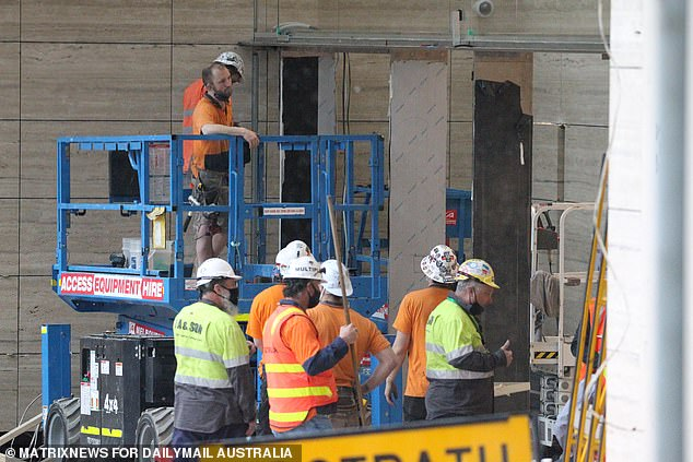 A'zero tolerance' Covid crackdown on Victoria's construction industry was launched on Monday, with 13 per cent of the state's outbreak linked to building sites. Pictured: Construction workers at a Melbourne site on September 3