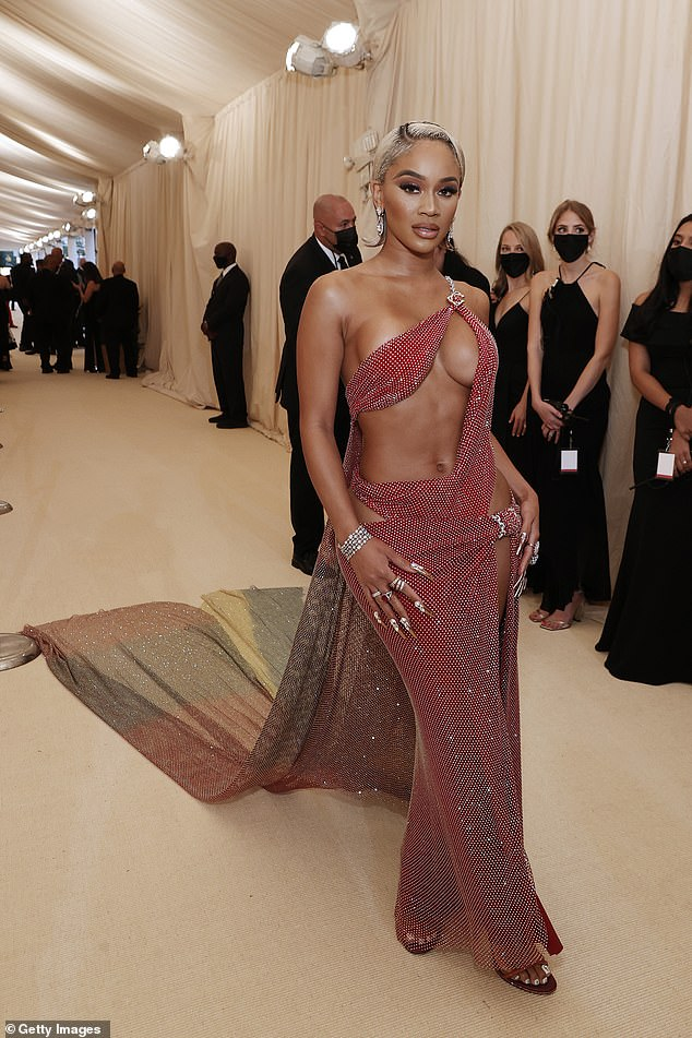Wow factor: Saweetieput on quite the eye-popping display in a Christian Cowan gown at the 2021 Met Gala in New York City on Monday