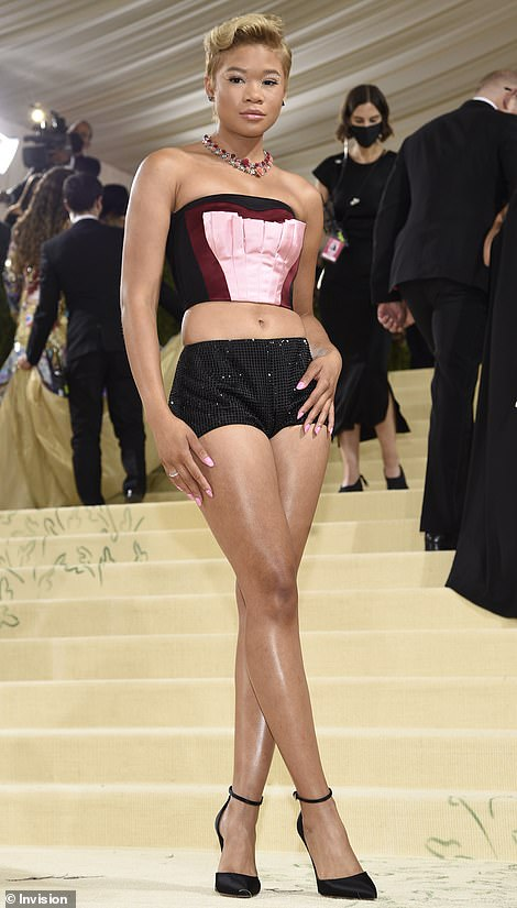 Woah: Actress Storm Reid arrived at the event in what appeared to be a pretty pink gown, however she soon whipped off her skirt to reveal a skimpy bustier and tiny pair of bedazzled shorts that looked a bit risque for such a glamorous gala
