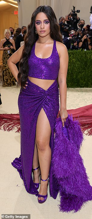 Leggy look: The look had a tall slit revealing her legs and purple platform heels that strapped just above her ankles