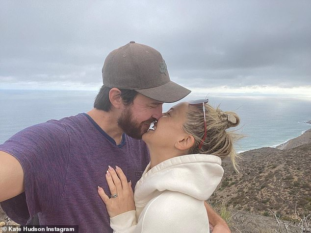Engagement photo:She took to Instagram on Monday afternoon to share a snap of the couple kissing while Hudson showed off the ring, adding, 'Let's go!' and a number of wedding emojis