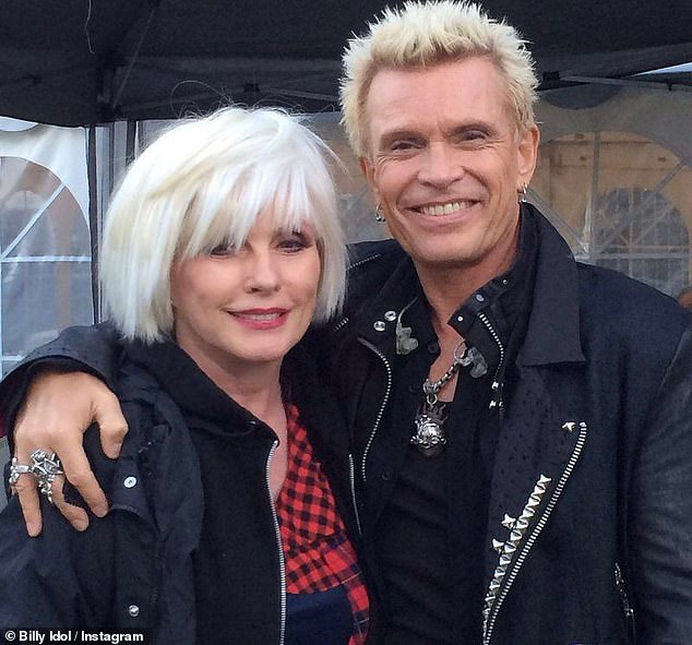 Punk roots: Harry and Blondie initially rolled in circles with underground and punk bands, but the band would hit it big with the=eir albumParallel Lines (1078); she is pictured with Billy Idol