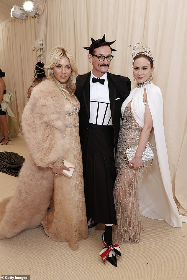 Three's company: Emily posed for snaps at the event with fellow actress Sienna Miller and fashion journalistHamish Bowles