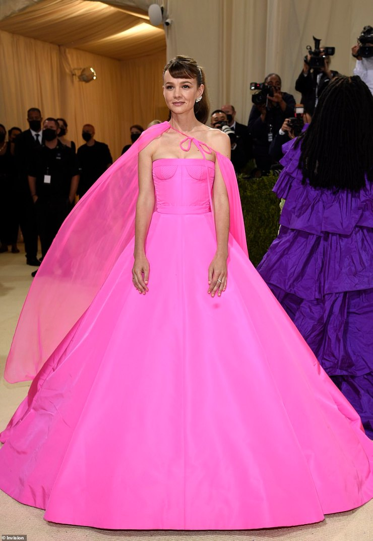 Pink princess: Carey Mulligan wore a hot pink number, complete with a majestic cape that was styled off to one side. The beauty is wearing Valentino Fall 2021 Haute Couture neon rose gown and cape