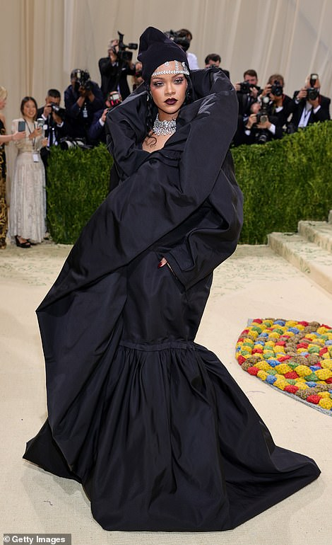 Rihanna donned a dramatic black Balenciaga overcoat with a matching hat; she is wearing 267 carats of Bulgari jewels
