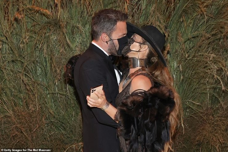 PDA session: Ben did not pose on the steps with Jennifer but was snapped soon after sharing kisses with her near the entrance - despite both of them wearing face masks