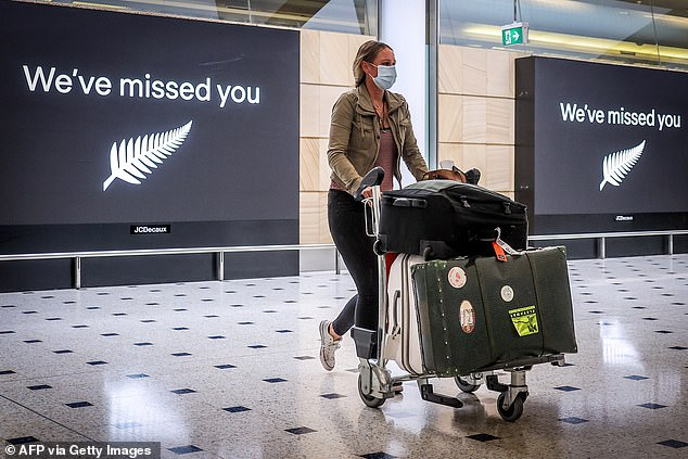 New Zealand's zero-Covid strategy could see the country being left behind as Australia's intense vaccination efforts mean international travel could resume as early as mid-November (pictured, a passenger arrives in New Zealand in October 2020)