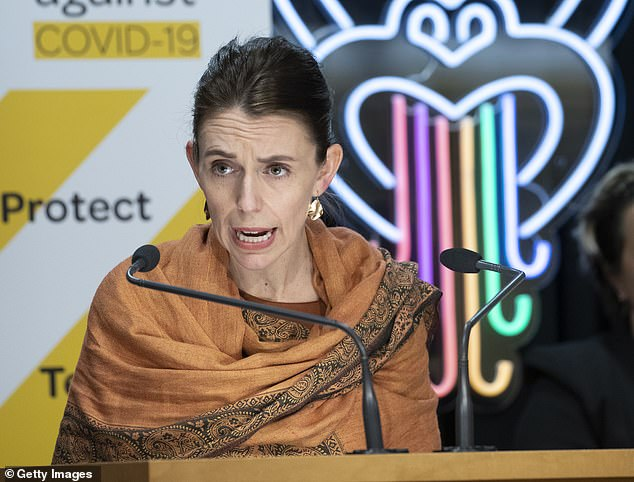 Holiday-hungry New Zealanders risk being left behind as their leader continues to push a zero-Covid policy, as Australia throws its doors open to the rest of the world (pictured, NZ Prime Minister Jacinda Ardern)