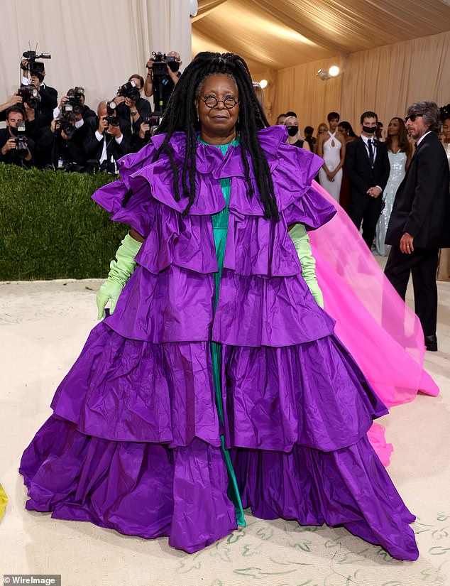 Festive: Whoopi Goldberg, 65,stepped out in a purple ruffled gown by Valentino at the 2021 Met Gala atthe Metropolitan Museum of Art on Monday